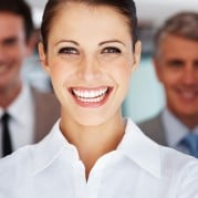 cheerful businesswoman l 179x179 - 4 Easy Steps to Setting Up An Employee Contest With Your Retail POS